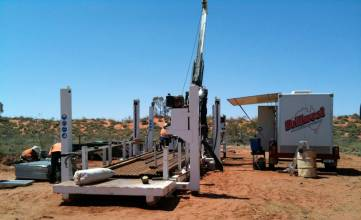 LF90 Diamond Drilling Rig on site, including custom built site office and jack up drill rod carrier.