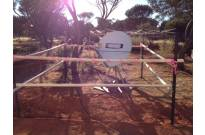Remote bush camp equipped with satellite communication system.